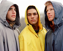 three men in rain jackets