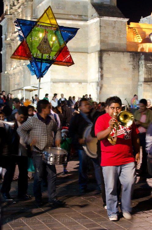 A trumpet player in a Christmas Eve posada, Oaxaca, Mexico
