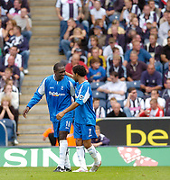 Photo: Leigh Quinnell.<br /> West Brom v Birmingham City. The Barclays Premiership.<br /> 27/08/2005.Emile Heskey celebrates his goal for Birmingham with Jermaine Pennant.