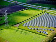 Nederland, Drenthe, Coevorden, 07-05-2021; hoogspanningsmast en groene akker met zonnepanlen in het voorjaar, 'groene stroom' - nabij Wachtum.<br /> luchtfoto (toeslag op standard tarieven);<br /> aerial photo (additional fee required)<br /> copyright © 2021 foto/photo Siebe Swart