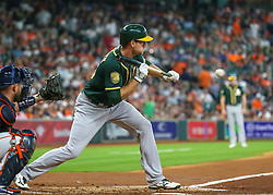 April 29, 2018 - Houston, TX, U.S. - HOUSTON, TX - APRIL 29:  Oakland Athletics right fielder Stephen Piscotty (25) bunts in the top of the third inning during the baseball game between the Oakland Athletics and Houston Astros on April 29, 2018 at Minute Maid Park in Houston, Texas.  (Photo by Leslie Plaza Johnson/Icon Sportswire) (Credit Image: © Leslie Plaza Johnson/Icon SMI via ZUMA Press)