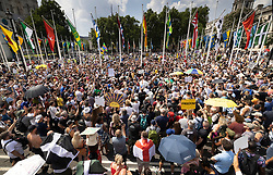 © Licensed to London News Pictures. 19/07/2021. London, UK. Protesters spill out of Parliament Square in central London on Freedom Day. All covid regulations in England are being scrapped from today even though infections and hospitalisations are on the increase. Photo credit: Peter Macdiarmid/LNP