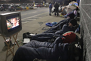 Town of Wallkill, NY -  Shoppers watch a movie on a television they set up while waiting in line outside a Best Buy store shortly after midnight on Black Friday, Nov. 28, 2008. People, including some in sleeping bags or tents, waited for a chance to buy items on sale when the store opened at 5 a.m.
