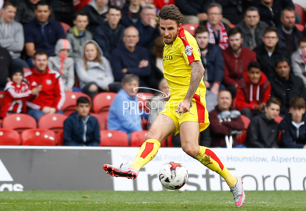Rotherham United striker Matt Derbyshire puts a dangerous cross infront of the Brentford goal during the Sky Bet Championship match between Brentford and Rotherham United at Griffin Park, London, England on 17 October 2015. Photo by Andy Walter.