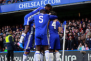 Chelsea players celebrate after Willian (hidden) scores their teams first goal. The Emirates FA Cup 4th round match, Chelsea v Brentford at Stamford Bridge in London on Saturday 28th January 2017.<br /> pic by Steffan Bowen, Andrew Orchard sports photography.