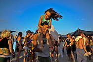 """Father and daughter dancing on the beach at """"Mid Burn"""" the Israeli """"Burning Man Festival"""" held at """"Habonim"""" beach north of Israel October 4-6, 2012."""