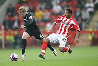Photo: Rich Eaton.<br /> <br /> Cheltenham Town v Nottingham Forest. Coca Cola League 1. 13/10/2007. Forest's Kris Commons (L) is tackled by Dean Sinclair (R)