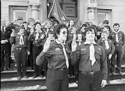 Scout Inducted Using Sign Language.   (P6)..1981..08.12.1981..12.08.1981..8th December 1981..Joe Needham, a deaf and dumb resident in Stewart's Hospital, Palmerstown, Co Dublin was enrolled into the 43rd Dublin (Palmerstown) unit of the Scouting Association of Ireland. The Chief Scout, Mr Joe McGough carried out the enrollment at the hospital. Ms Domenica Malocca, a teacher in the class for the deaf at the hospital, translated the Scout Promise into sign language during the ceremony...Image shows Joe Needham, Estelle Feldman,Scout Leader and the scouts of the 43rd Dublin Unit giving the scout salute at the front of Stewart's Hospital.