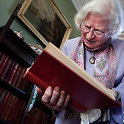 """Phyllis Dorothy James, Baroness James of Holland Park, OBE, FRSA, FRSL (born 3 August 1920), commonly known as P. D. James, is an English crime writer and Conservative life peer in the House of Lords, most famous for a series of detective novels starring policeman and poet Adam Dalgliesh. She is also the author of Children of Men, which was the basis of the feature film of the same name, directed by Alfonso Cuarón. Here she is photographed at her home in London. P.D.James is looking through the book """"The Trial of Buck Ruxton"""" from her library of crime stories."""