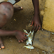 Young boys fishing in the beach by the city of São Tomé
