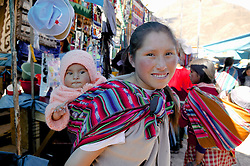 Mother & Child At Pisco Market