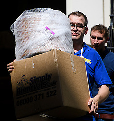 """© Licensed to London News Pictures. 16/07/2016. London, UK. Items marked for """"TV ALCOVE"""" being placed in a van for David Cameron. Removal men begin to take items from numbers 10 and 11 at Downing Street at the end of the week that saw Prime Minister David Cameron leave and Theresa May arrive. Photo credit: Ben Cawthra/LNP"""