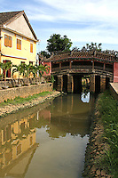 The Japanese Covered Bridge in Hoi An was erected in 1593 and is still in use today by pedestrians and cyclists. Inside the bridge there is a small temple; the two entrances of the bridge are guarded by dog figurines on one side and monkey figurines on the other.
