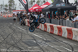 Champion stunter Aaron Colton performed at the RSD Moto Beach Classic. Huntington Beach, CA, USA. Sunday October 28, 2018. Photography ©2018 Michael Lichter.