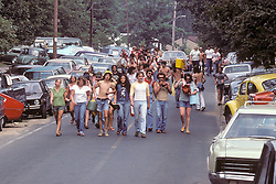 People On the Way to Experience The Grateful Dead Concert at Raceway Park, Englishtown NJ on 3 September 1977, Labor Day Weekend. On The Road into the Show. Cropped from the original format.
