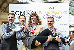 Windsor, UK. 5th March, 2019. Winners of the gold medal in the 13th Windsor and Eton Flippin' Pancake Challenge pose after the race on Shrove Tuesday in aid of Alexander Devine Children's Hospice Service and Windsor Homeless Project.