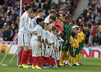 Football - 2016 / 2017 World Cup Qualifier - UEFA Group F: England vs. Lithuania<br /> <br /> The teams line up for the national anthems at Wembley.<br /> <br /> COLORSPORT/DANIEL BEARHAM