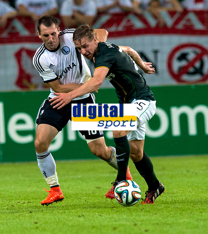 30/07/14 UEFA CHAMPIONS LEAGUE THIRD ROUND QUALIFIER FIRST LEG<br /> LEGIA WARSAW V CELTIC<br /> PEPSI ARENA - WARSAW<br /> Stefan Johansen (right) is chased down by Legia Warsaw's Michal Kucharczyk.