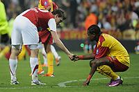 FOOTBALL - FRENCH CHAMPIONSHIP 2010/2011 - RC LENS v STADE BRESTOIS 29 - 16/04/2011 - PHOTO : ALAIN GADOFFRE / DPPI - DECEPTION HENRI BEDIMO (RCL)/ ROMAIN POYET (SB29)