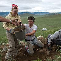 ASmithsonian Museum archaeology team led by Dr. Bruno Frohlich unearths 2700+ year-old, khirigsur burial mounds at a site near Muren, Mongolia  L to R: Eliza Wallace, Thomas Frohlich & Manlaibaatar Sundev.