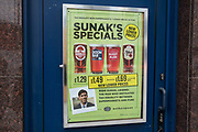 An advertisement for reduced-price beer bearing an image of Chancellor of the Exchequer Rishi Sunak and the words Sunak's Specials is pictured on a door to a Wetherspoons public house on 26th November 2020 in Slough, United Kingdom. Tim Martin, founder and chairman of JD Wetherspoon, had campaigned for tax equality between pubs and supermarkets.