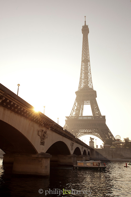 The iconic Eiffel Tower standing on the banks of the River Seine in Paris, France