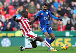 Leicester City's Riyad Mahrez (right) and Stoke City's Kurt Zouma battle for the ball during the Premier League match at the bet365 Stadium, Stoke-on-Trent.