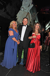 Left to right, LORD & LADY FINK and their daughter GABRIELLA FINK at The Global Party held at The Natural History Museum, Cromwell Road, London on 8th September 2011.