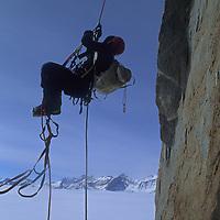 Rick Ridgeway jumars up steep east face of Rakekniven Spire, Queen Maud Land, Antarctica.