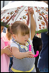 August 5, 2017 - United Kingdom - Image licensed to i-Images Picture Agency. 05/08/2017. Gatcombe Park, United Kingdom. The Queen's great-granddaughter Mia Tindall with an umbrella on a wet and windy  second day of the Festival of British Eventing at Gatcombe Park, United Kingdom.  Picture by Stephen Lock / i-Images (Credit Image: © Stephen Lock/i-Images via ZUMA Press)