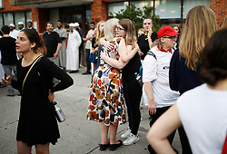 People comfort each other following a vigil remembering the victims of a shooting on Sunday evening on Danforth, Ave. in Toronto, ON, Canada, on Monday, July 23, 2018. Photo by Mark Blinch/CP/ABACAPRESS.COM