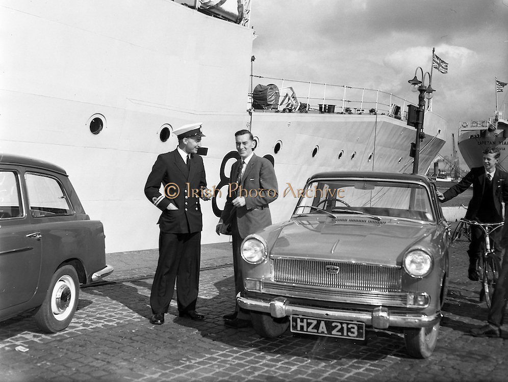 """07/09/1960<br /> 09/07/1960<br /> 07 September 1960<br /> British Navy vessel """"Malcolm"""" in Dublin.<br /> The British Navy fishery protection vessel Malcolm (1,500 tons) flagship of the R.N. Protection Squadron commanded by Captain H.H. Bracken arrived for a five day visit in Dublin Lincoln and Nolan of Dublin supplied two Austin cars for the use of the officers during their stay and handed over the keys to the navy men on arrival. Picture shows Lieutenant James Royal Australian Navy receives the keys of one of the Austin cars from Mr Jack O'Donoghue  P.R.O. Lincoln and Nolan."""