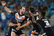 GOLD COAST, AUSTRALIA - MARCH 07:  Pat Richards of the Tigers celebrates kicking a field goal with team mates during the round one NRL match between the Gold Coast Titans and the Wests Tigers at Cbus Super Stadium on March 7, 2015 on the Gold Coast, Australia.  (Photo by Matt Roberts/Getty Images)