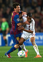 BARCELONA, SPAIN - APRIL 03:  Lionel Messi (L) of Barcelona competes for the ball with Robinho of AC Milan during the UEFA Champions League quarter-final second leg match between FC Barcelona and AC Milan at the Camp Nou stadium on April 3, 2012 in Barcelona, Spain.  (Photo by Manuel Queimadelos Alonso/Getty Images)