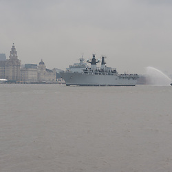 LIVERPOOL, UK, 28th May, 2013. HMS Bulwark and HMS Edinburgh seen leaving Liverpool as part of a Royal Navy fleet visiting the city as part of the 70th Anniversary of the Battle of the Atlantic.