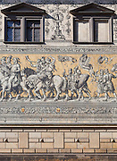 The Fürstenzug (English: Procession of Princes) in Dresden, Germany. A large mural of a mounted procession of the rulers of Saxony. It was originally painted between 1871 and 1876 to celebrate the 800th anniversary of the Wettin Dynasty, Saxony's ruling family. In order to make the work weatherproof, it was replaced with approximately 23,000 Meissen porcelain tiles between 1904 and 1907. With a length of 102 metres (335 ft), it is known as the largest porcelain artwork in the world. The mural displays the ancestral portraits of the 35 margraves, electors, dukes and kings of the House of Wettin between 1127 and 1904.