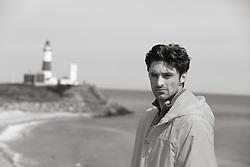 handsome man on the beach near the Montauk Lighthouse in Montauk, NY