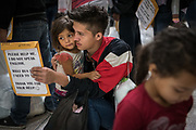Kerlin Lopez, an asylum seeker from Honduras, waits with daughter Brikne, 3, at a bus depot after being released from federal detention in McAllen, Texas, U.S., March 20, 2019.