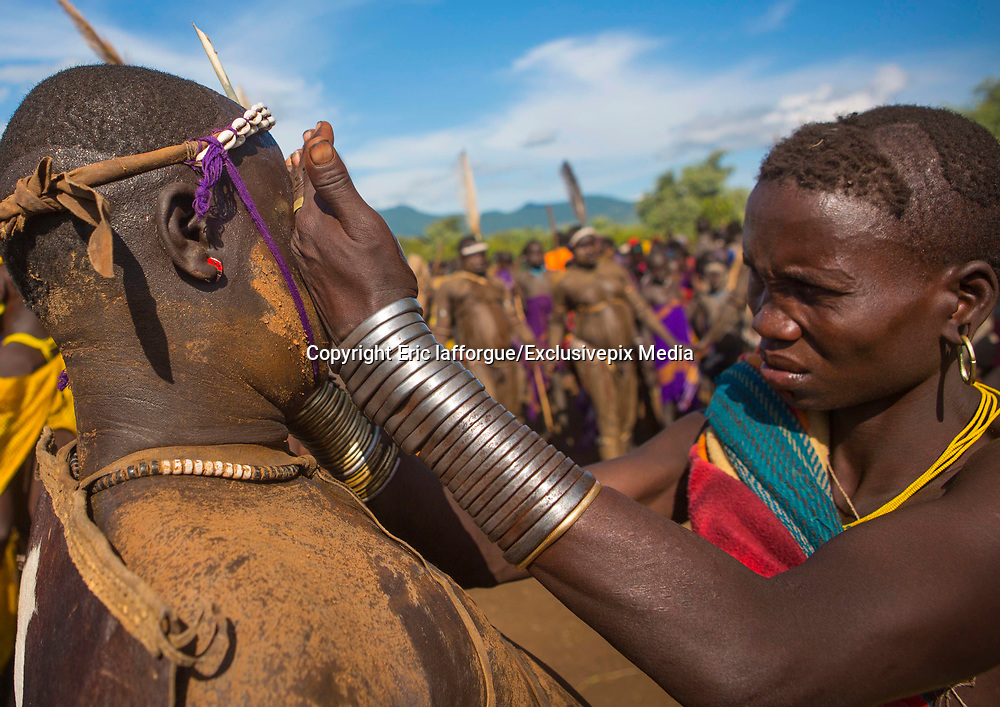 BODI TRIBE FAT MEN<br /> (very) big is beautiful<br /> <br /> Every  year,  takes  place  in the deep south of Ethiopia, in  the <br /> remote  area of Omo valley, the celebration of  the  Bodi  tribe  new <br /> year: the Kael.For  6  months  the  men  from  the tribe will   feed   themselves with only fresh  milk  and  blood  from <br /> the cows. They will not  be allowed to  have sex and to go out of their  little hut.  Everybody will take care of  them, the  girls  bringing  milk  every morning in pots or bamboos. The  winner  is  the  bigger.  He  just <br /> wins fame, nothing special. This  area does not  welcome tourists and has kept his traditions<br /> <br /> Photo shows: The women take care of the fat men: they give them alcohol, remove the sweat, and sing for them to keep them awake.<br /> ©Eric lafforgue/Exclusivepix Media