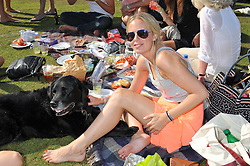 ASTRID HARBORD and her dog Guinness at a cricket match to in aid of CARE - Corfu Animal Rescue Establishment held at Hawkley Cricket Club, Hawkley, Hampshire on 8th September 2012.