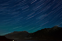 Night Sky, Star Trails, and Northern Lights looking northeast from Haines, Alaska. Composite of images from 00:30 to 00:59 taken with a Nikon D3x camera and 45 mm f/2.8 PC-E lens (ISO 400, 45 mm, f/5.6, 29 sec). Raw images processed with Capture One Pro and the composite generated using Photoshop CC (statistics, maximum).