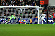 Swansea city's Wayne Routledge (15) scores his sides 3rd  goal (his 2nd). Barclays Premier league, Swansea city v West Bromwich Albion at the Liberty Stadium in Swansea on Wednesday 28th November 2012. pic by Andrew Orchard, Andrew Orchard sports photography,