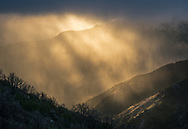 Sun bursts through storm clouds in the Los Padres National Forest, Monterey County, California