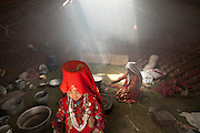 Women doing the cooking inside the yurt..Daily life at the Khan (chief) summer camp of Kara Jylga...Trekking through the high altitude plateau of the Little Pamir mountains (average 4200 meters) , where the Afghan Kyrgyz community live all year, on the borders of China, Tajikistan and Pakistan.