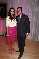 LADY NATASHA RUFUS-ISAACS and EDWARD TAYLOR at the Lauren-Perrier 'Pop Art' Pink Party in aid of Capital 95.8's Help A London Child, held at Suka at the Sanderson Hotel, 50 Berners Street, London W1 on 25th April 2007.<br /><br />NON EXCLUSIVE - WORLD RIGHTS