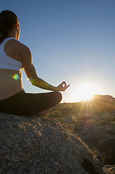 Woman sitting in lotus position at sunrise (Credit Image: © Image Source/Les & Dave Jacobs/Image Source/ZUMAPRESS.com)