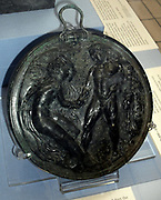 Heracles attempting to abduct the nymph Auge.  Mirrors were usually owned by women, but may have been gifts from their male lovers.  Many of the mirrors dating to the 4th century BC show scenes of abduction and male dominance: the subjects reflect the subordinate place women held in society.  Made about 330-300 BC
