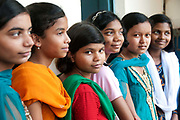 India. Orissa. Girl pupils line up to have their eyes tested.