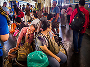 11 APRIL 2018 - BANGKOK, THAILAND:  A woman rests while she waits for a train at Hua Lamphong train station in Bangkok on the first day of the Songkran travel period. Songkran is the traditional Thai New Year and is one of the busiest travel periods of the year as Thais leave the capital and go back to their home provinces or resorts in tourist areas. Trains and busses are typically jammed the day before the three day Songkran holiday starts. The government has extended the official holiday period through Monday, 16 April because one day of the Songkran holiday fell on the weekend, giving many workers a five day holiday.      PHOTO BY JACK KURTZ