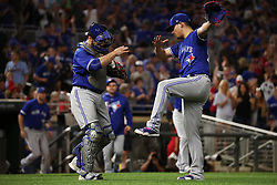 September 15, 2017 - Minneapolis, MN, USA - Toronto Blue Jays catcher Russell Martin, left, celebrates with relief pitcher Roberto Osuna after the final out in a 4-3 win against the Minnesota Twins on Friday, Sept. 15, 2017, at Target Field in Minneapolis. (Credit Image: © Anthony Souffle/TNS via ZUMA Wire)